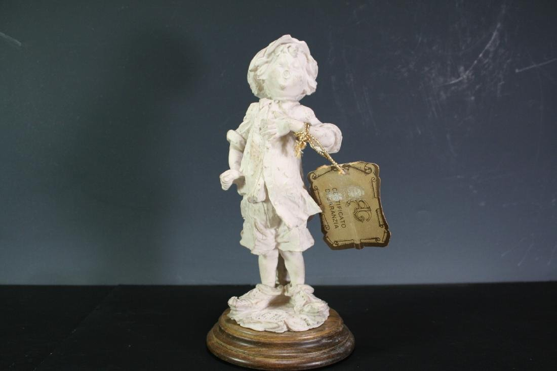 Porcelain Figurine of a Boy