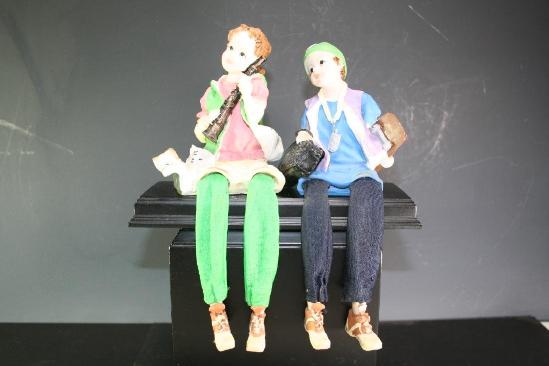 Group of Two Porcelain and Fabric Figurines