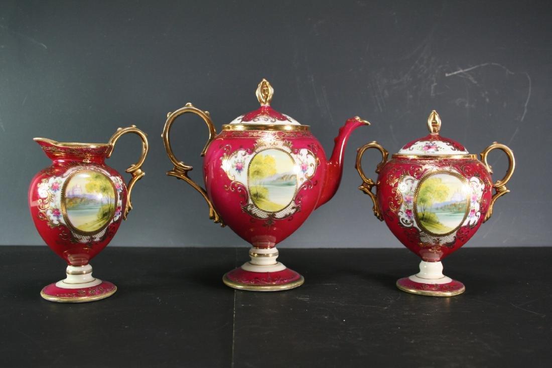 Set of Three Gilt Porcelain Items