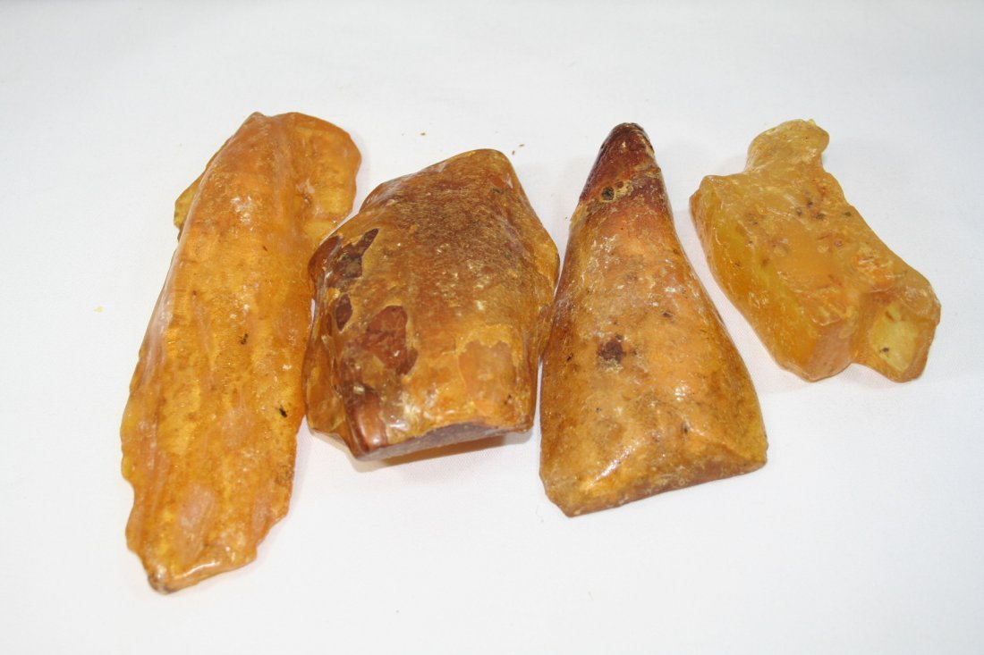Group of Four Pieces of Ambers