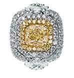 A YELLOW DIAMOND AND DIAMOND RING