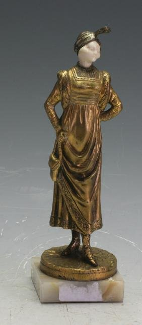 A bronze and  figure