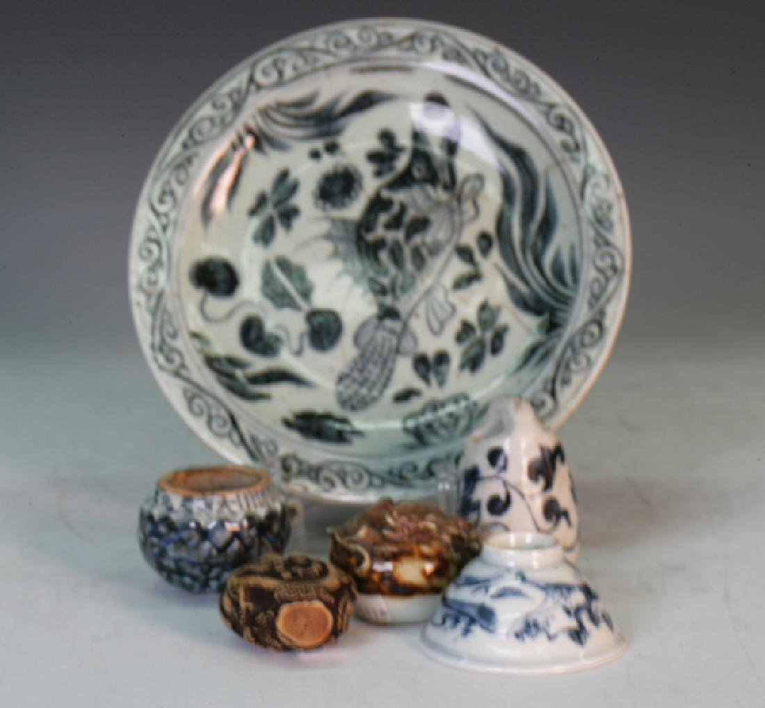 A blue and white plate and other items