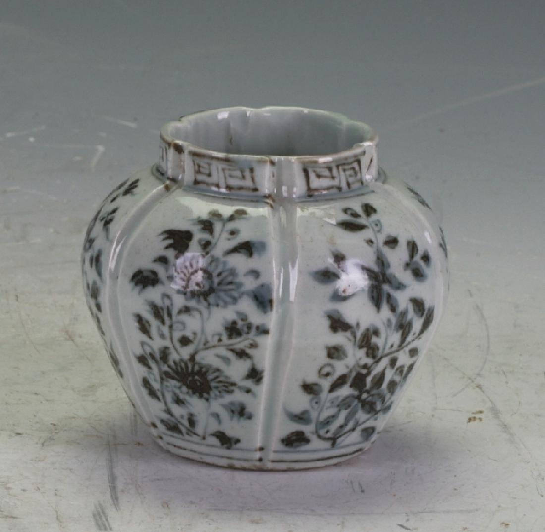A small blue and white jar