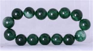 A Jade-Like Glass Bracelet.