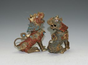 A Pair Of Repousse Copper Figures