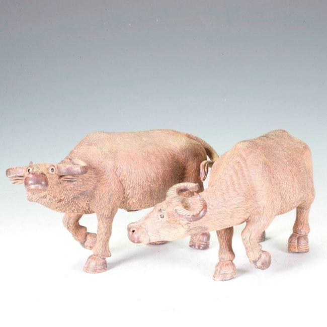 Pair of Ceramic Buffalos