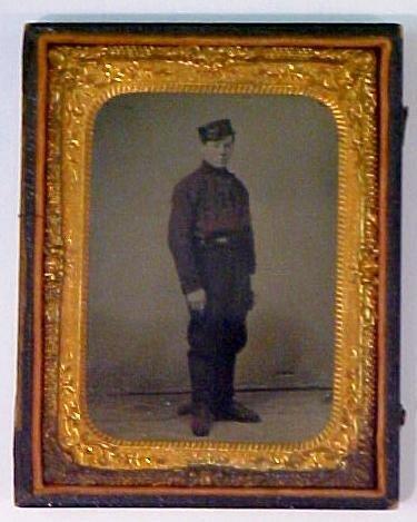 6: Tintype of man wearing H shirt