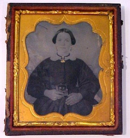 12: Tintype of seated women