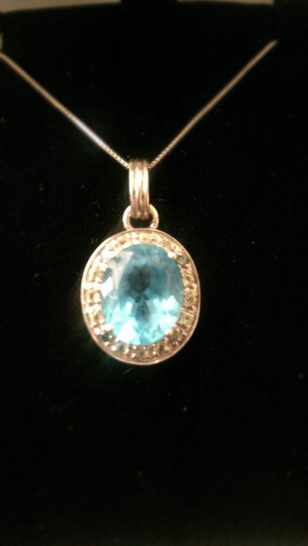 Blue Topaz and Diamonds pendant, in 14k white gold