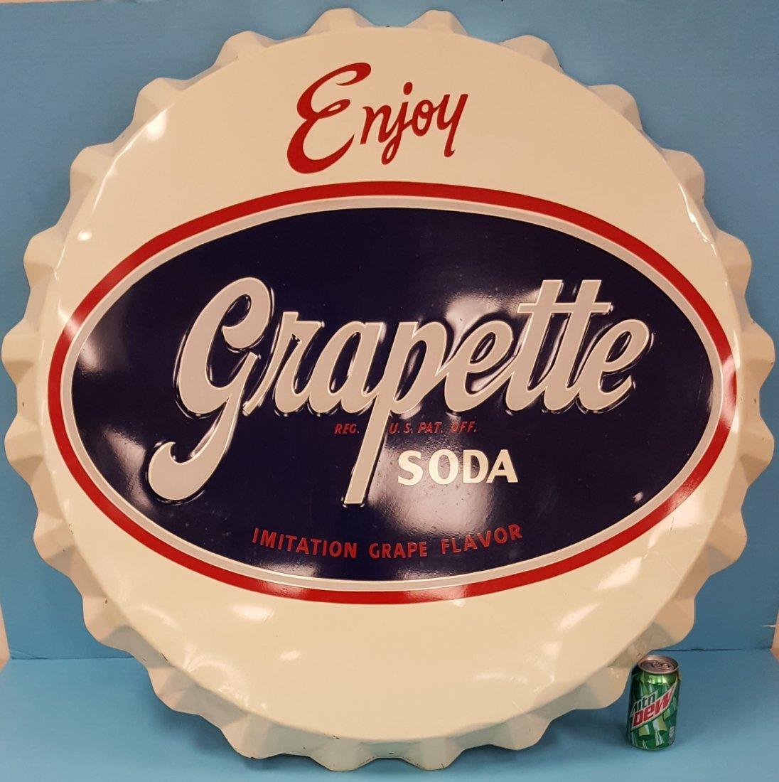 Grapette Embossed Bottle Cap Sign
