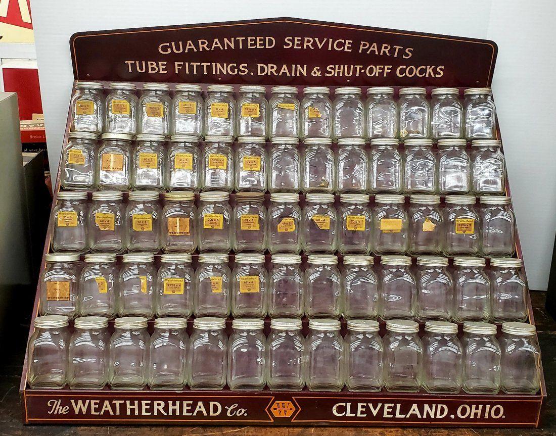 Weatherhead Service Parts Display Cabinet and Jars