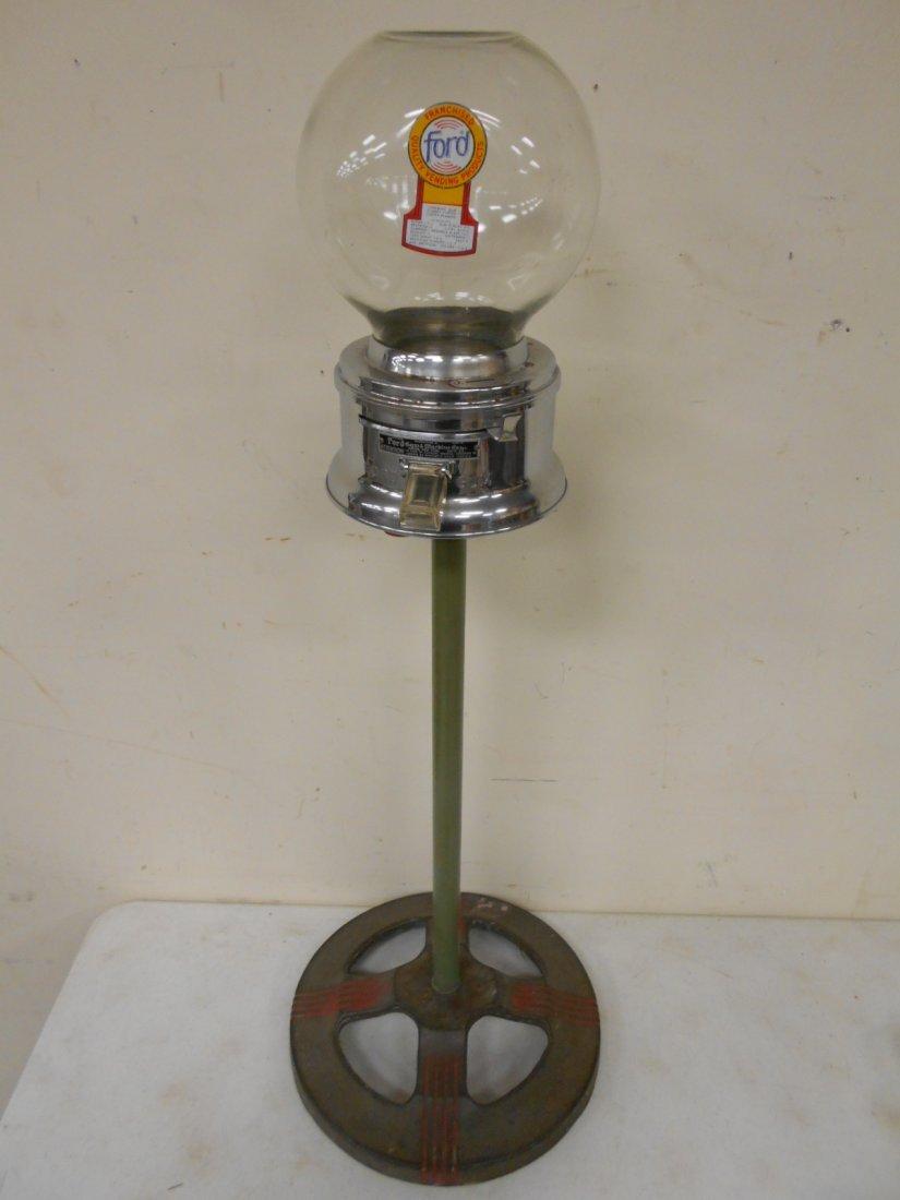 Ford bubble gum machine on deco cast iron base
