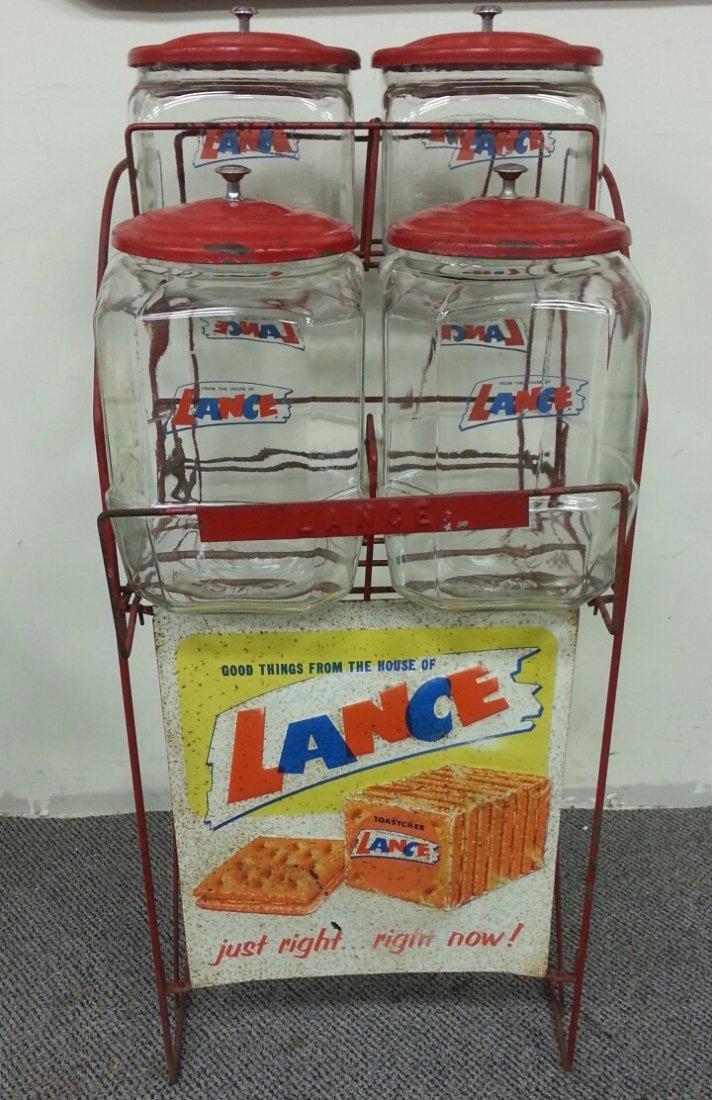 Country store Lance rack w/ 4 jars & original lids