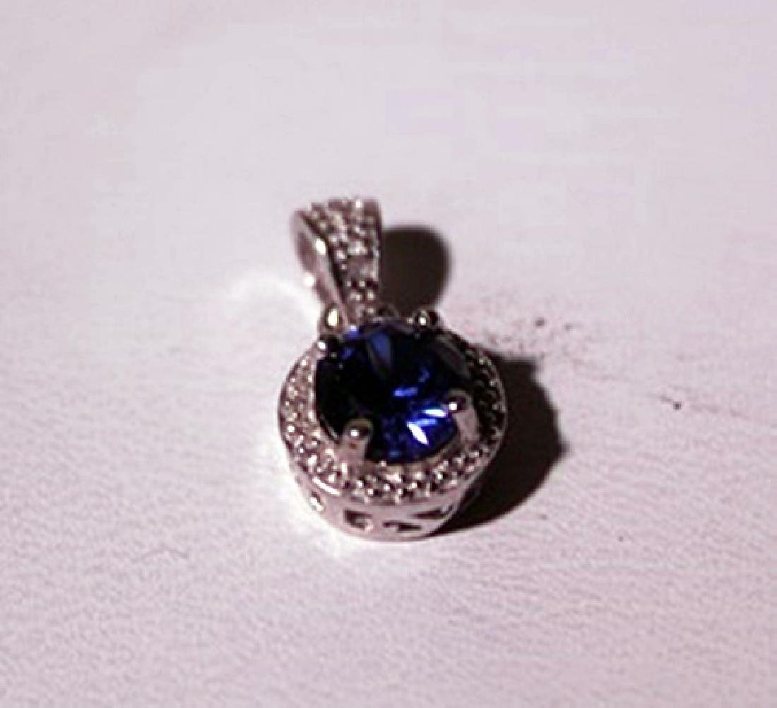 Exquisite Sterling Silver Pendant with Lab Blue