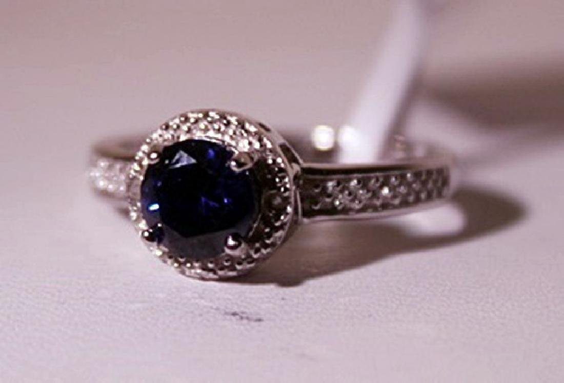 Exquisite Sterling Silver Ring with Sapphire and