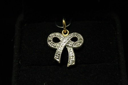 Beautiful 14kt Gold over Silver Bow Diamonds Pendant