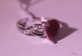 Exquisite Sterling Silver Ring with Pear Cut Pigeon