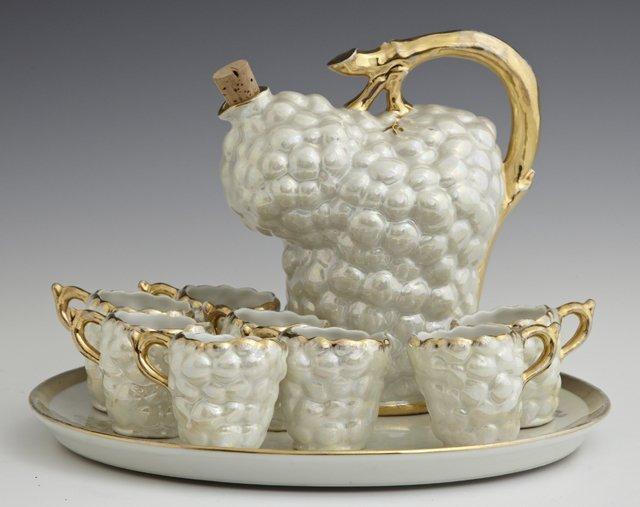 Ten Piece Limoges Porcelain Liqueur Set, 20th c., with