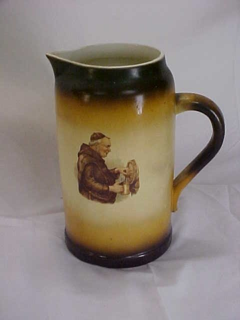 14: Limoges China Monk hand painted pitcher