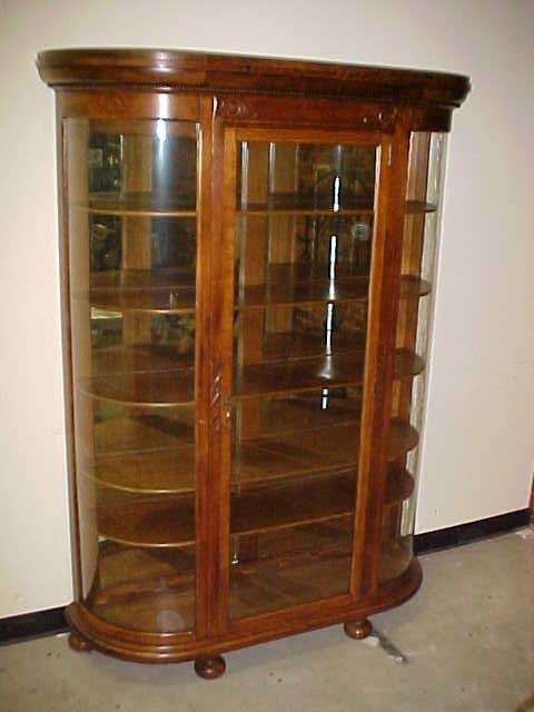 110: Large oak curved glass china cabinet