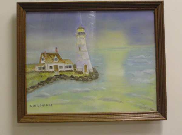 11: OIL ON CANVAS OF A SEASCAPE AND LIGHTHOUSE