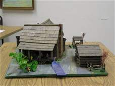 12 STRUCTURE OF A LOG CABIN AND OUT BUILDINGS