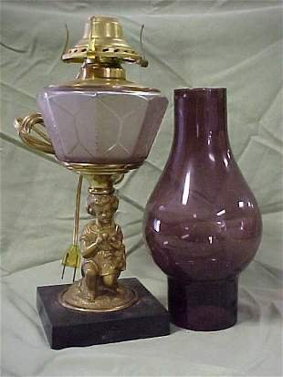 Cherub lamp with amethyst shade