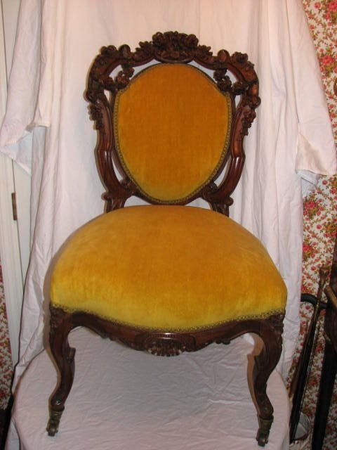 13: Victorian carved walnut parlor chair.
