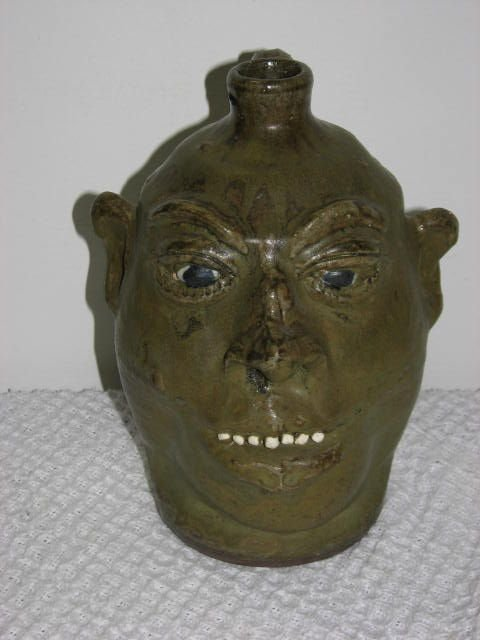 13: Signed Lanier Meaders face jug Southern pottery.