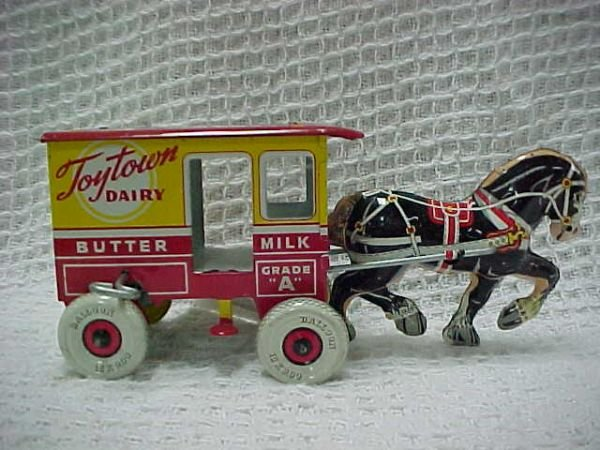 1511: Marx Toy Town Dairy wind up tin litho w/horse.