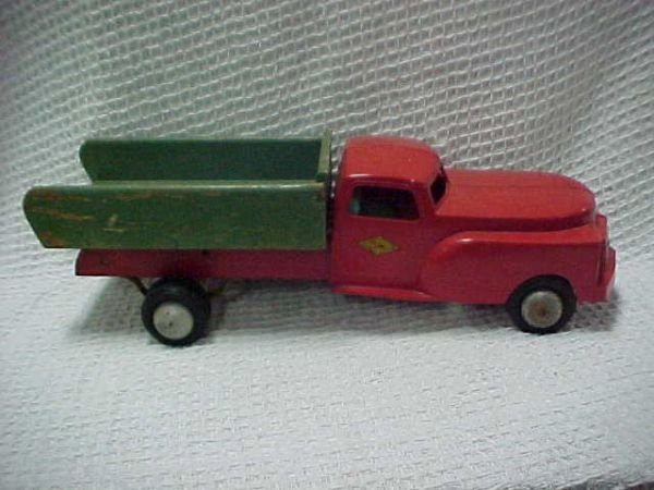 1512: Cass Toys Truck plastic front wood frame & bed.