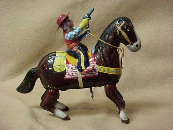 3024: Wind up tin litho cowboy on horse Haji