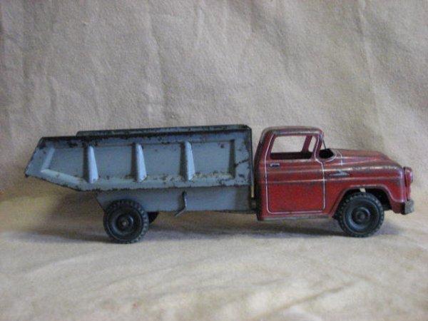3: Steel truck Red cab grey body 1950's