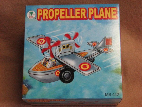 8: Repo wind up tin litho airplane