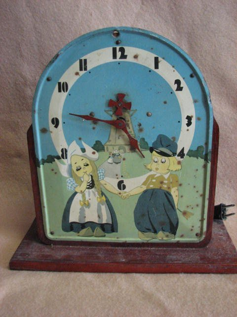 15: Vintage childs clock on stand.