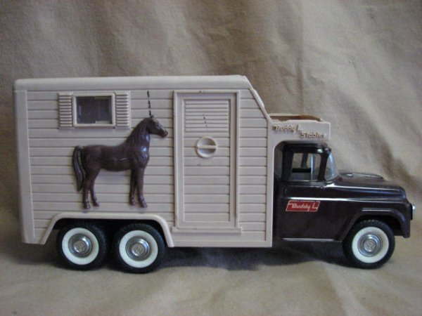 17: 1960's Buddy L stable truck.