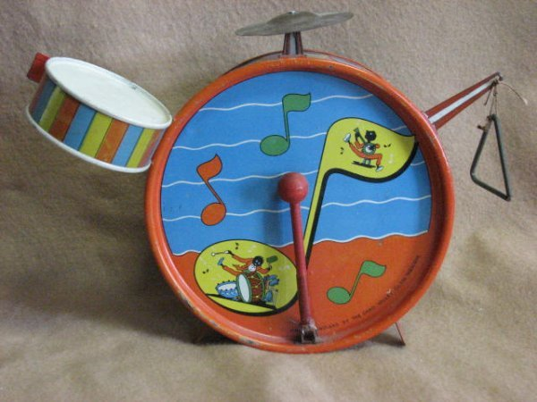 18: Toy drums w/black characters tin litho.