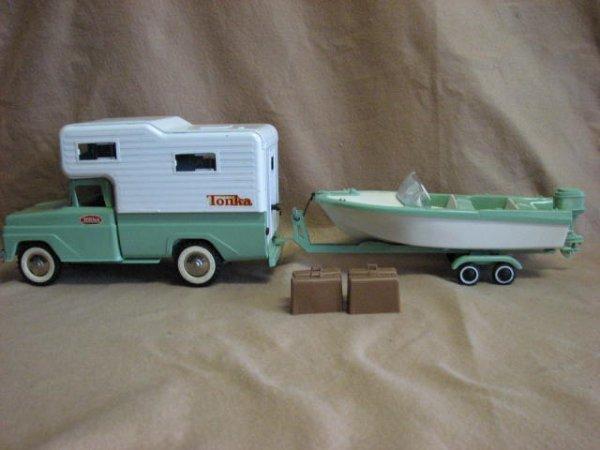 20: 1960's Tonka pickup truck w/camper & boat.
