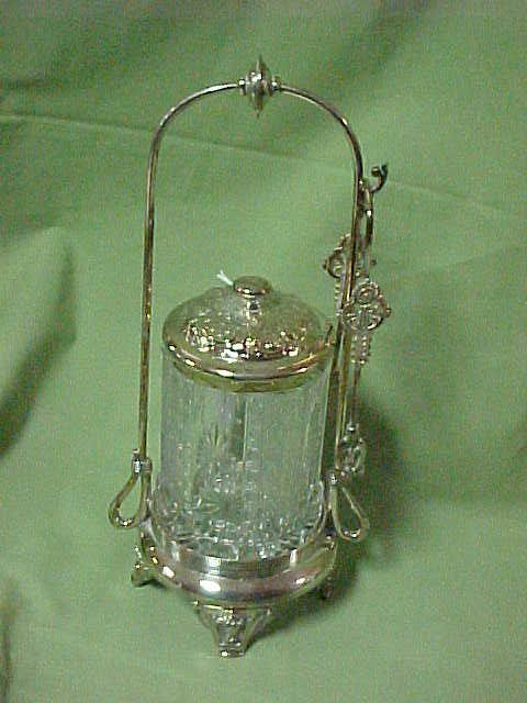 Rogers Smith Co. Victorian pickle castor w/tongs.