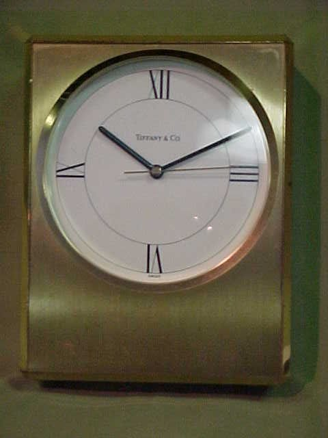 215: Tiffany Co. brass case clock.