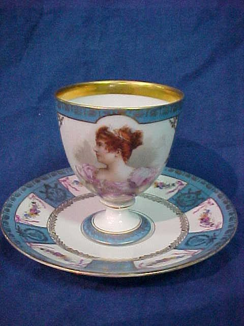 219: Beautiful hand painted cup & saucer porcelain.