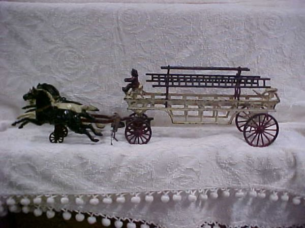 143: Antique cast iron fire truck with horse team