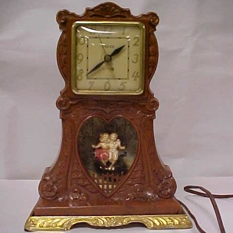 Clock with swinging boy and girl
