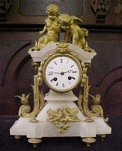 859: Antique French white onyx bronze mantel clock