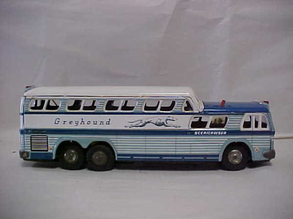 1420: Vintage battery operated Greyhound toy bus