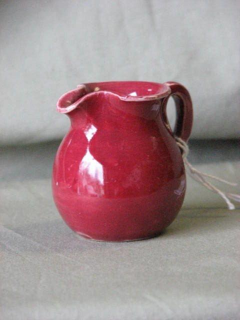 3: Small W.J. Gordy red glaze pitcher