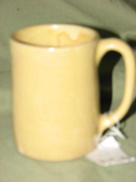 6: Georgia Art pottery cup by Darrell Adams.  Yellow gl