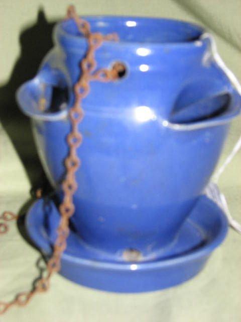 13: W.J. Gordy hanging strawberry planter blue glaze.