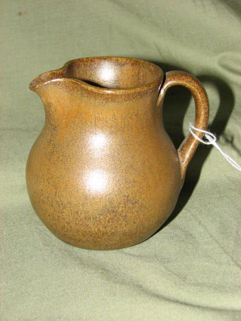 17: W.J. Gordy Mountain gold glaze pitcher.